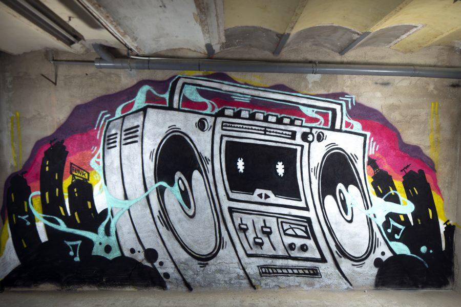 a graffit art work of a boom box ghettoblaster on a wall