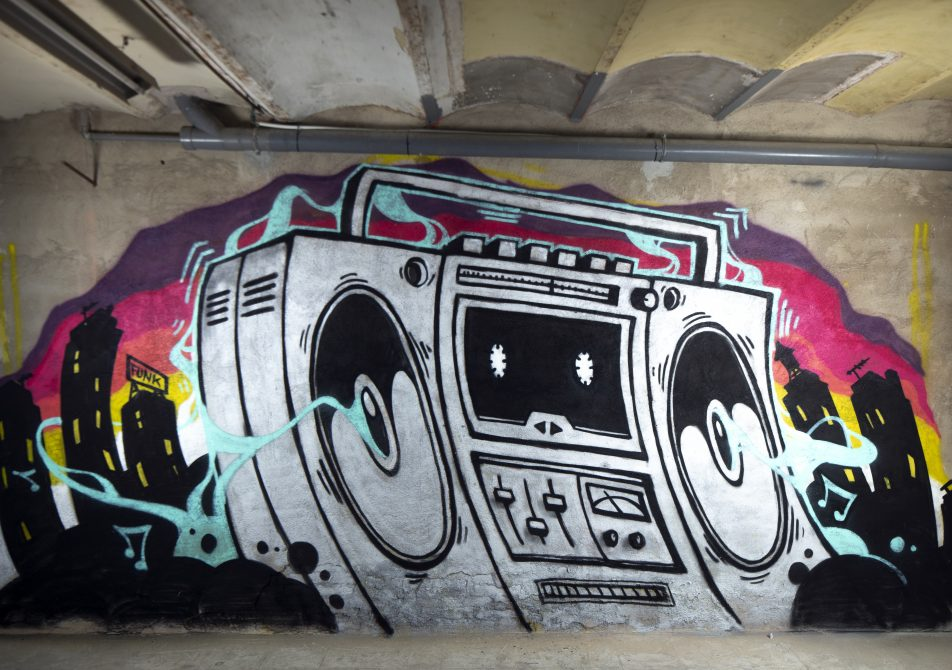 a graffit art work of a boom box ghettoblaster on a wall